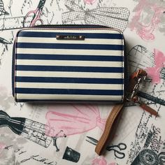 Stella & Dot wristlet wallet Navy blue and white stripes. Signs of normal wear still in pretty good condition. No trades. Bundle and save. Reasonable offers please. All sales go towards paying off my husband's headstone. Thanks. Stella & Dot Bags Clutches & Wristlets