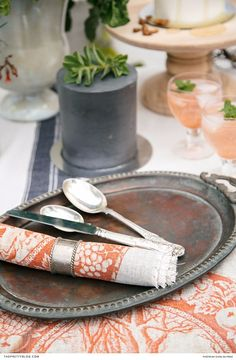 Jazz up your dinner table with this vibrant linen, featuring quirky prints in a burnt orange shade.