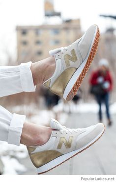 White pants and New Balance sneakers