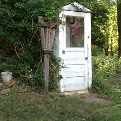 Shed/out house made of doors~my solution to not finding an old outhouse for my yard!