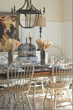 I love the white distressed chairs and the chandelier.