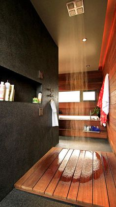 Marmol Radziner house - wood indoor shower and shower niche.  Solid surface or polished concrete wall.