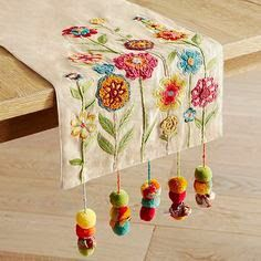 Table Runners : Table Linens - Something to cheer about: Our brightly colored table runner with embroidered and appliqued flowers, corded tassels and sprightly pompoms. Ribbon Embroidery, Embroidery Art, Embroidery Stitches, Embroidery Patterns, Table Linens, Table Runners, Needlework, Tassels, Diy And Crafts