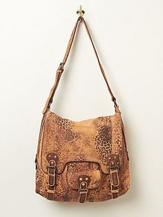 Free People - Leopardito Bag. Leopard print suede crossbody messenger with brass hardware and an adjustable shoulder strap