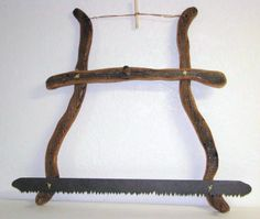 Rustic barn board hand saw with metal saw teeth - perfect for towel holder in cabin