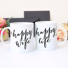"""This adorable set of mugs makes a memorable gift for any couple with our """"Happy Wifey"""" & """"Happy Life"""" mug set. This mug set is perfect for the most stylish pair. Great for the coffee or tea loving cou"""