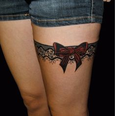 A sexy little bow is a great feature to a lacy garter. #inked #garter #lacetattoo #lace #bow #bowtattoo
