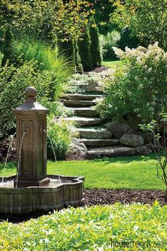 Water fountains serve as focal points in a back yard