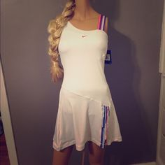 SOLD ** NWT White Nike Tennis Dress **SOLD White with pink and blue stripe, this adorable tennis dress has never been worn. I own 2 others of this same dress, just in different colors. The fabric is great for movement and keeping you cool while you play. Unfortunately for me I am too pale to successfully pull off white anything :/ Nike Dresses