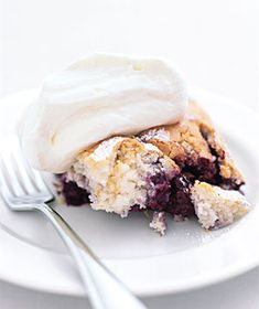 Blackberry Cobbler  butter for the baking dish  3  half-pint containers fresh blackberries or one 16-ounce bag frozen unsweetened blackberries, thawed  2  tablespoons  confectioners' sugar  2  cups  pancake mix  1  cup  whole milk  2  large eggs  1  7- or 8-ounce container whipped cream