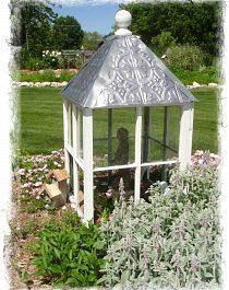 My garden cupola  A friend brought over some old windows knowing that I would do something fun with them. The outcome? This fun large garden cupola over my septic tank! The roof is plastic ceiling tiles.