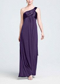 This long jersey dress is right on trend with the one shoulder strap. It has charmeuse on the bust and straps to give this dress some polish, while a long cascade back adds a goddess feel to the look. This dress can be dressed up or down depending on the event. Available in extra length sizes. Available in sizes 2-30. Dry clean only.