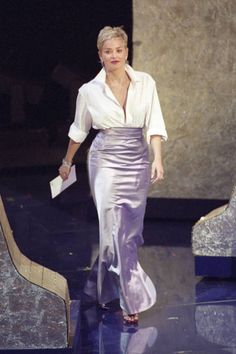SHARON STONE, IN 1999 Sure, the lilac-colored Vera Wang skirt was beautiful. But it was the shirt that Sharon Stone paired it with—her then-husbands crisp white button-up from the Gap—that made this a memorable fashion moment, proving once again you dont have to spend a fortune to look like a million bucks. Our style reflects what we think about ourselves, Stone later said. Its more attitude than the event of the clothes.