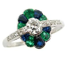 Art Deco diamond, emerald and sapphire cluster ring, c.1925. S.J. Philips.