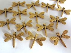 Decorative Dragonfly Push Pins. Made in USA of lead free metal.  Has a nail on back to push into soft wood or bulletin board!