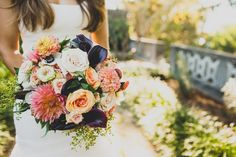 Dark eggplant flowers with pops of pinks and soft oranges make this bouquet absolutely stunning! To see more from Jackie and Brian's wedding check out their gallery at SoireeBySouleret.com ! Beautiful photo taken by @ryzphotography