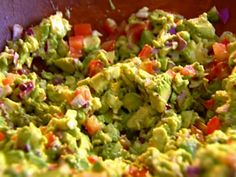 Ina Garten's Guacamole- with red onion & tomatoes. We love this guacamole recipe- so yummy!