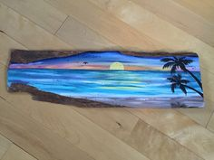 This one of a kind Coastal Decor art piece is created from an amazing driftwood find. Hand painted with a beautiful sunset, beach scene. Size 25x8x3/4  The driftwood was found in Florida and the scene is inspired by many Florida Sunsets Ive enjoyed over the years. Sarasota, FL being my absolute favorite place to watch amazing sunsets. This driftwood wall art would make a great gift for any lover of Nautical Decor, Coastal Decor or just any Beach/Sunset in general! This is a one of a kind…
