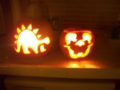 Fun family night carving pumpkins. **first we had to scoop out all the seeds...(well, i scooped them out, blaine  wouldn't touch them...they...