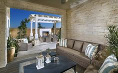 A covered Legacy Room maximizes natural light and facilitates indoor-outdoor living. - Residence 1 at Crawford at Greenwood in Tustin, CA