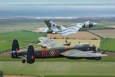 Battle of Britain Memorial Flight Lancaster with the Vulcan. 2014.