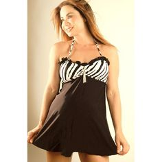 Ruffle Zebra Bandeau Maternity Swimsuit. A perfect mix and match of black and white color in this maternity bathing suit. Zebra striped maternity bandeau top with removable accessory. Bandeau top has zebra straps that tie at neck. Solid black bottom is designed to cover your bottom. Bikini bottoms (underneath) are tie side and full coverage. Maternity swimwear is non refundable, exchangeable for in store credit only.