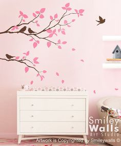 I plan to bring a bit of nature into baby's room via wall decals. I've always loved birds and trees. The colors on these are customizable. Found on Etsy.
