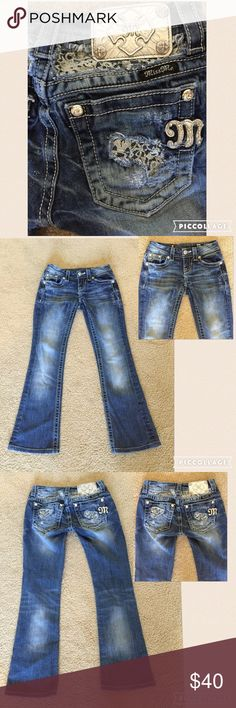 """Miss Me Jeans with Lace Accents Miss Me Jeans with Lace Accents on back pockets and waistband. Has rhinestone rivets at pockets. Size 24 measures: 28"""" around top, 16.5"""" across hips, 27"""" inseam. They have been professionally hemmed (originally 33"""" inseam). 98% cotton, 2% stretch. FM1000/071716 Miss Me Jeans"""