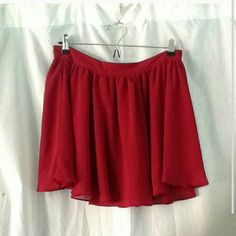 F21 maroon flowy skirt medium forever21 size Medium chiffon gathered skirt with a back zipper. Has two layer, top layer is sheer with a liner on the the inside. Color is not like the picture, it's a dark maroon color. Worn a few times, still looks good. Forever 21 Skirts