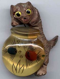 Rare wood cat dipping into a reverse carved and painted applejuice Bakelite fish bowl pin. Vintage Costume Jewelry, Vintage Costumes, Vintage Jewelry, Vintage Clothing, Coco Chanel, Cat Watch, Cat Jewelry, Jewellery Box, Leather Jewelry