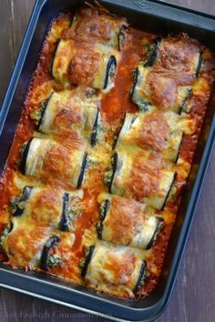 ingredients 2 large eggplants 1 cup (9 oz/ 250 g jar) reduced fat ricotta 1 1/2 cups shredded light mozzarella, divided in 1/2 cup and 1 cup 1/2 cup shredded parmesan 9 oz / 250 g frozen spinach, thawed and squeezed to remove as much liquid as possible 1 egg 1 garlic clove, germ removed, minced salt and pepper to taste 1 cup tomato passata or marinara directions Preheat oven to 400F/200C. Remove eggplants' ends and slice them thinly. Spray a baking sheet with olive oil and place 12 e
