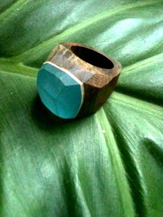 Turquoise sea and wood ring