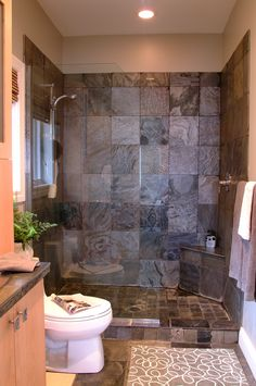 I really like this layout for a small bathroom.  Instead of a glass wall in the shower, I want tile about four feet up. I like the little corner bench too.