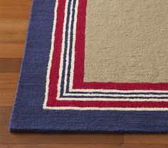 Blue, red, & tan nursery room rug :: Tailored Striped Rug potterybarnkids.com