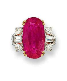 "AN IMPRESSIVE RUBY AND DIAMOND RING, Mounted with an oval-shaped ruby weighing 12.99 carats to the pear-shaped and tapered baguette-cut diamond trifurcated shoulders with plain hoop, ring size 6½, stamped ""750""."