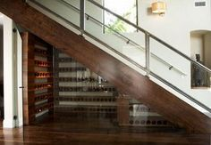 Beautiful banister, I love this open wine cellar too