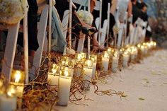 Candles and curly willow lining the aisle