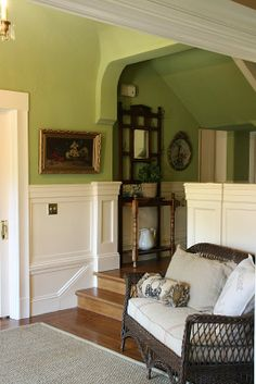 Love all the moldings and the green wall color.