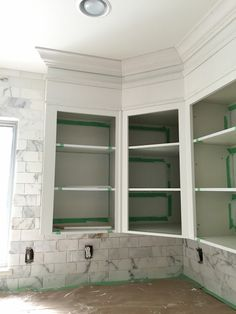 Marcus Design's kitchen reno...extending cabinets to ceiling with drywall and moulding.