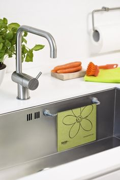 Cleaning Tips : Magnetic Holders for the Sink - Keep your sponge and cleaning rug clean and out of the way!