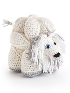 Amamani is short for Amigurumi Amish Puzzle Animals. They are based on the traditional Amish puzzle ball and, as such, come apart into three segments or rings, which have to be assembled to form the animal. Gauge isn't important in these projects.  http://www.maggiescrochet.com/collections/crochet/products/amamani-puzzle-balls