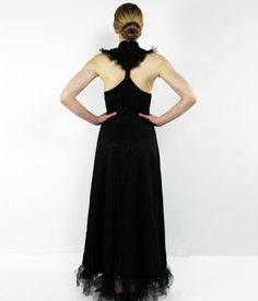 $375 Silk, black gown with tulle bottom, dramatic side slit, classic Chinese details, and back cut out. If Audrey Hepburn had dim sum instead of a croissant in Breakfast at Tiffany's, this is what she would wear. Designed by Amanda Curtis, Made in the USA, for sale on www.19thAmendment.co
