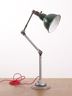 Vintage brass adjustable electric table lamp piano lamp desk lamp an industrial desk lamp by dugdills england painted steel with vitreous enamel shade rewired with red three core antique flex keyboard keysfo Image collections