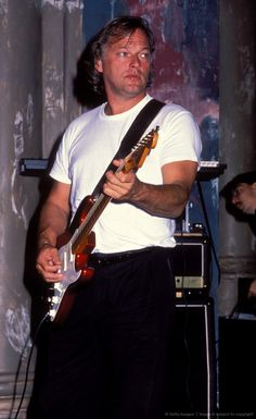 Using his red Strat with the EMGs from the 1980s. He still has it in his guitarmory.