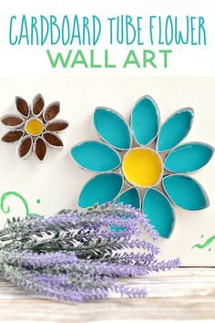 This flower cardboard tube wall art is so simple (and cheap!) to put together. Craft it in just one quick afternoon! via @familyfooda0336