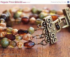 CLEARANCE Green Brown Picasso Czech Glass Bracelet (6.5 inch) by AlliecatDesignStudio on Etsy https://www.etsy.com/listing/151583784/clearance-green-brown-picasso-czech