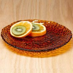 "Amber dinnerware sparkles and shines with a decorative pebble pattern. 1"" h, 8 1⁄2"" diam."