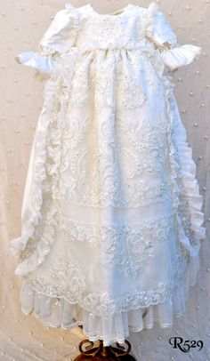 This beautiful Victorian inspired Christening gown Is made in the European 45 long style, an open back, a little longer and is for either boys