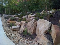 Rock Boulder Slope Landscaping Design Source by toniimarie Sloped Backyard Landscaping, Landscaping With Boulders, Sloped Yard, Landscaping Retaining Walls, Landscaping Supplies, Landscaping Tips, Rock Retaining Wall, Farmhouse Landscaping, Landscaping Software