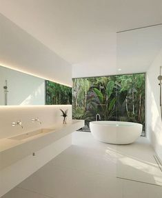 there are actually a number of ways to apply minimalist style into your bathroom design. From employing clever storage on the corner of the room to adding smart finishes, you can get the most of your bathroom with minimalist style. To help get started, here are the top nine ideas to consider.